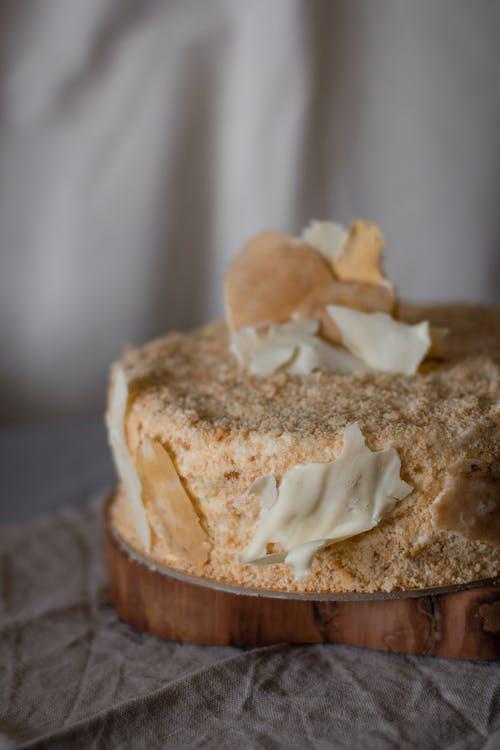 Yummy vanilla cake on table in bakery studio