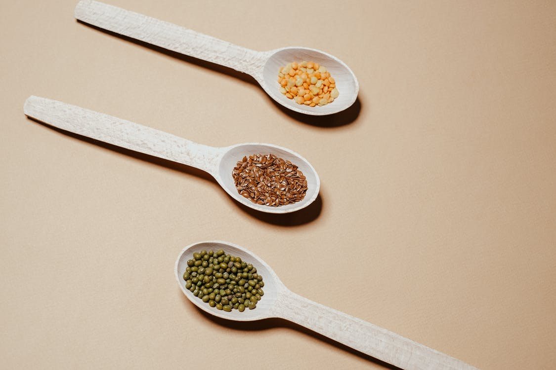 White Wooden Spoon With Brown Powder