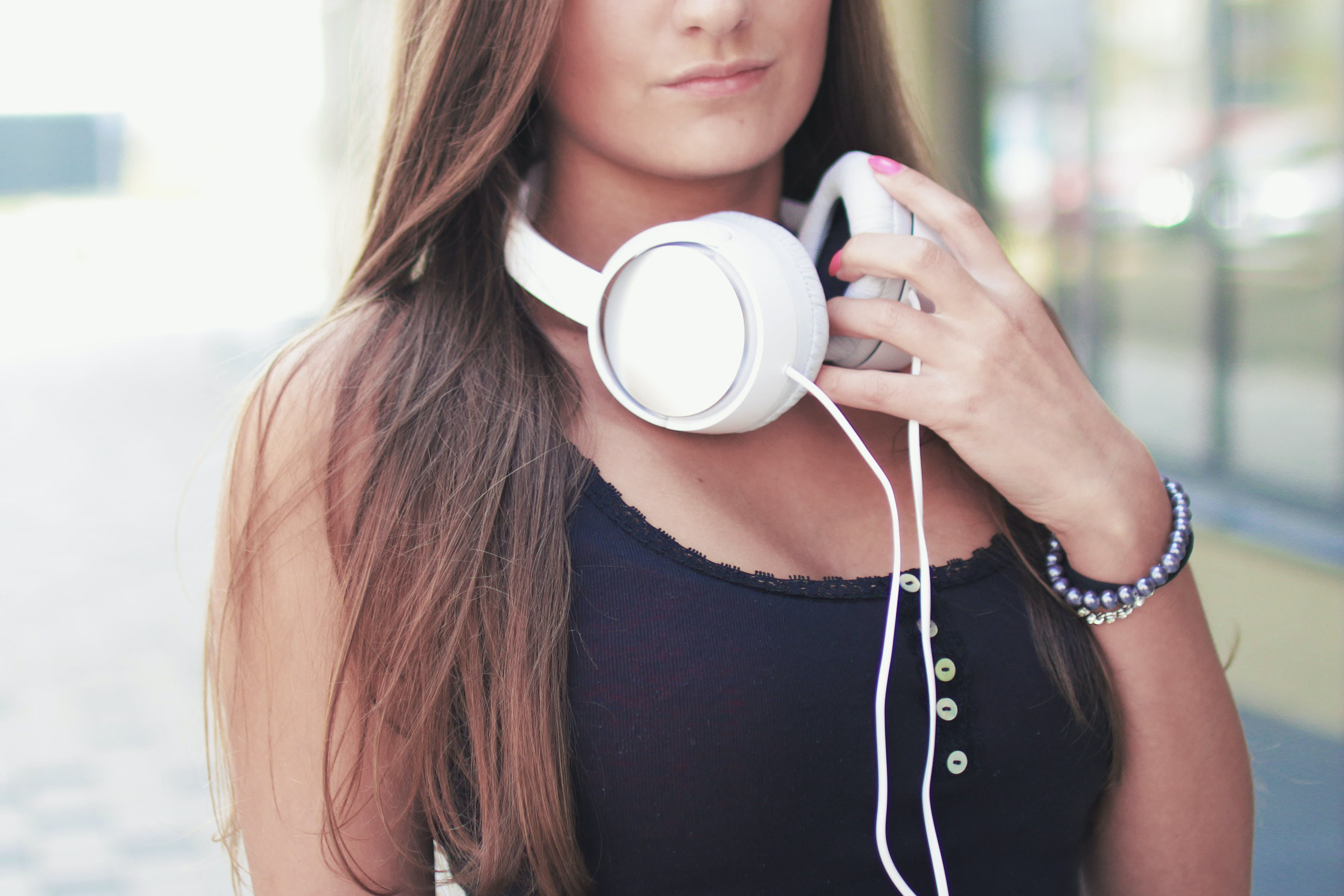 Portrait Photography of Woman Holding Headphones