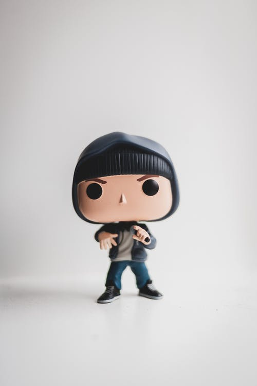 Full length of collectible little figurine of character of film wearing jeans and hoodie