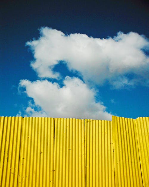 Free stock photo of clouds, fence, sky