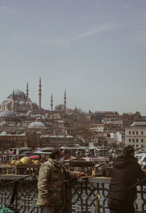 Fishermen and the Scenic View of the Blue Mosque in Istanbul