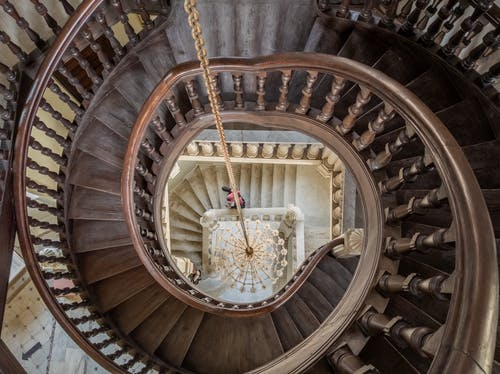 A Person on a Spiral Staircase