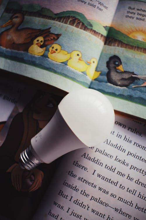 Light bulb placed on books for children