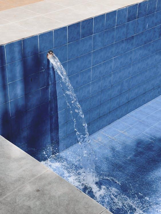 Water Fountain on Brown Brick Wall