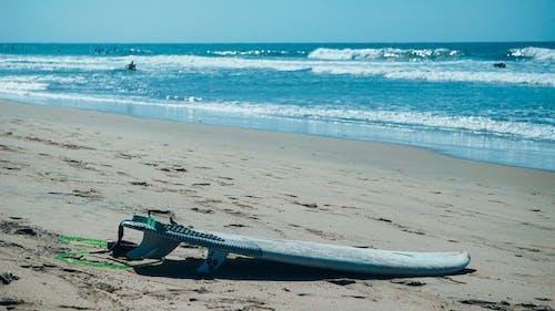 Surfboard Lying On A Beach