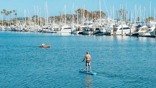 Men on a Paddleboard and Kayak