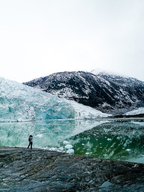 An Adventurer Looking at the Pia Glacier
