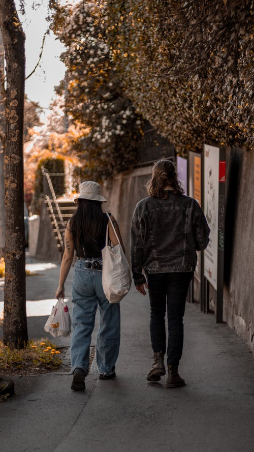 People Walking on the Sidewalk