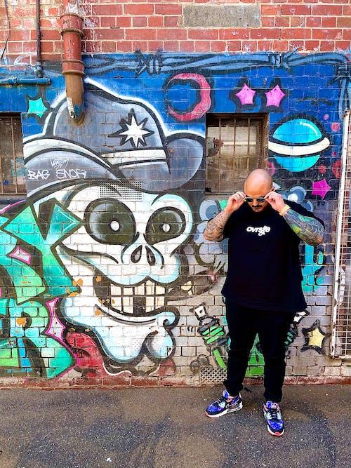 A Stylish Man and a Graffiti Art Wall