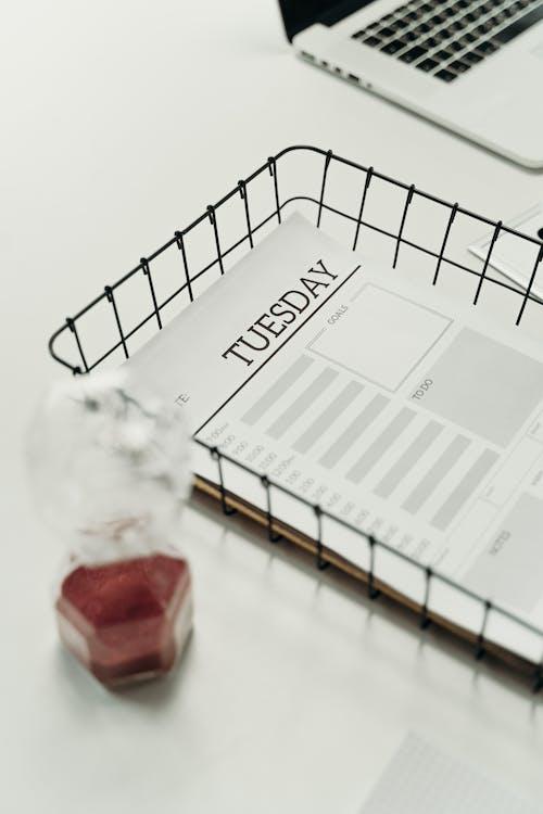 Hourglass Beside a Wire Basket