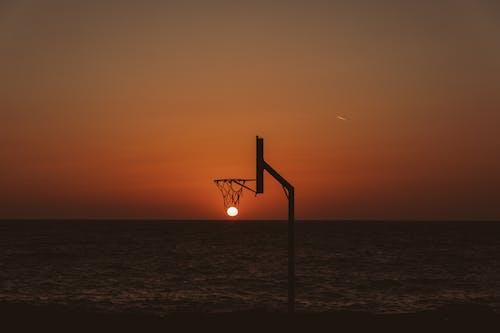Basketball backboard against picturesque sundown