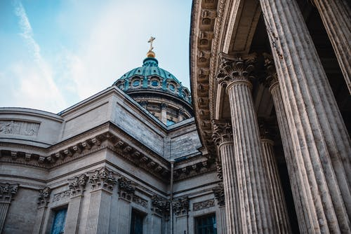 From below of facade of historic famous Kazan Cathedral with tall columns in Saint Petersburg