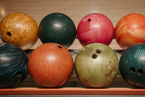 Colorful Bowling Balls on a Rack