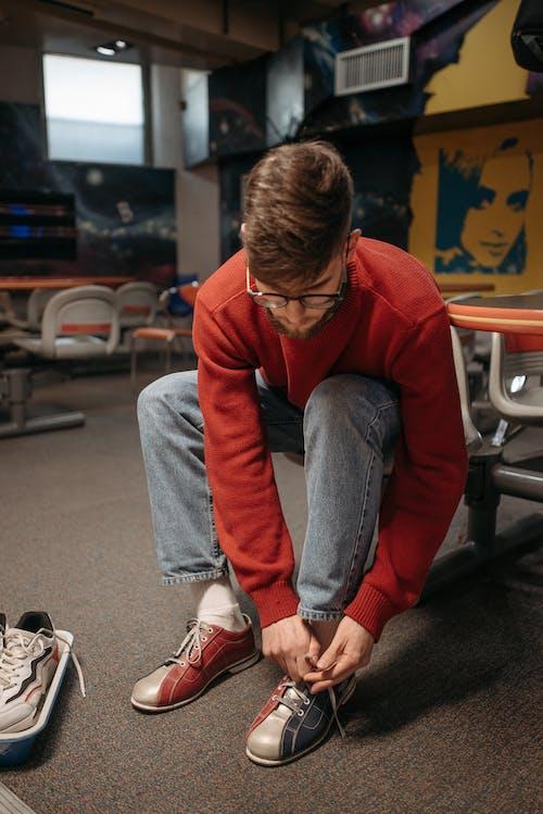 A Man Tying His Bowling Shoe