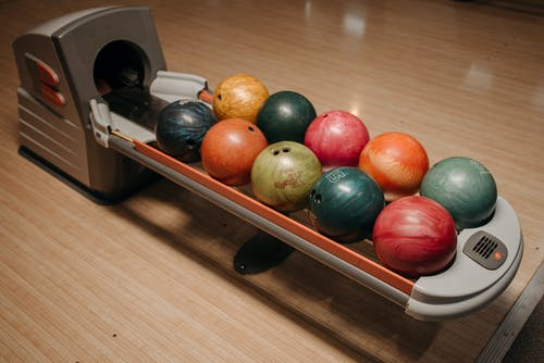 Colorful Bowling Balls on a Return System