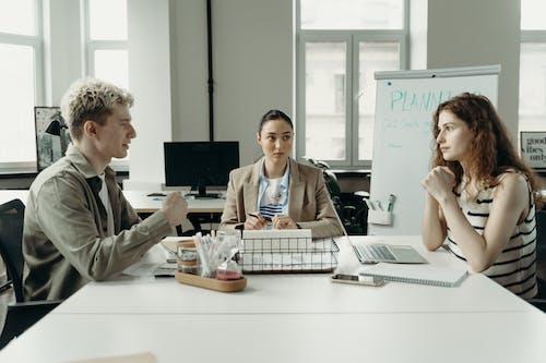 Woman in Gray Jacket Sitting Beside Woman in Gray Jacket