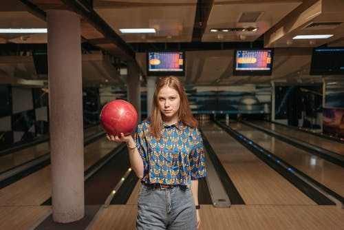 A Woman Holding a Bowling Ball