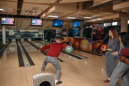 Friends Playing Bowling for Recreation
