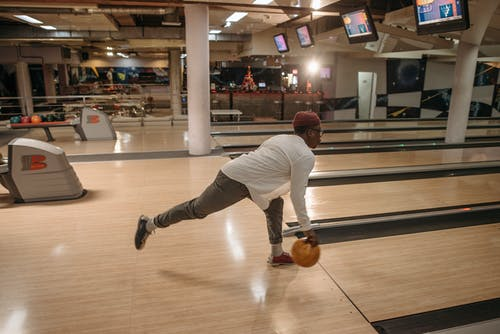 A Man Releasing a Bowling Ball