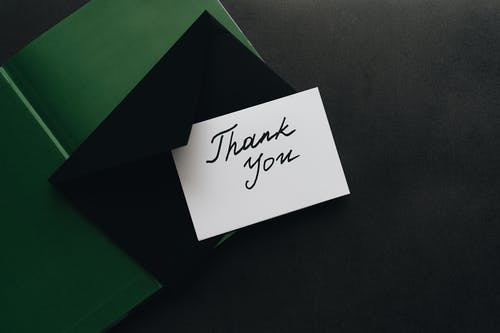 Thank You Card on Top of an Envelope