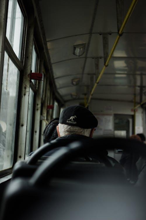 An Elderly Person Riding a Bus