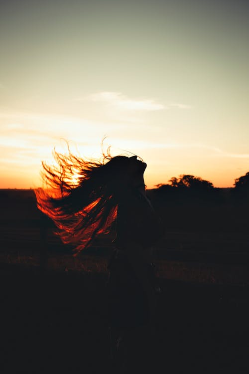 A Silhouette of a Person with Flying Hair