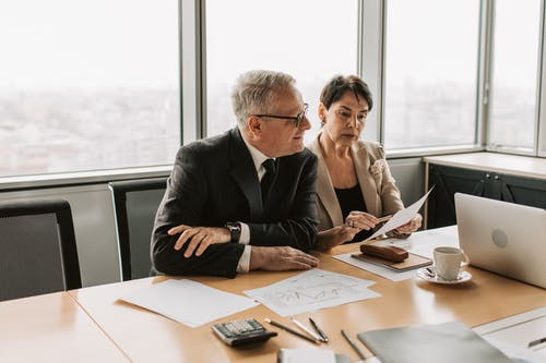 A Man and a Woman Sitting in the Office