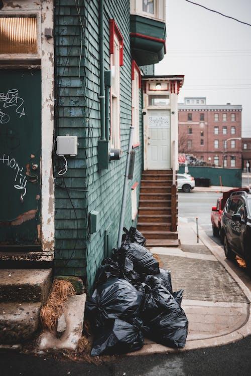 Garbage bags near building on street