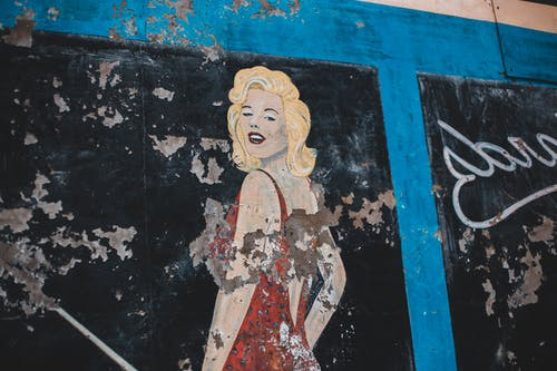 Painting of woman on shabby wall