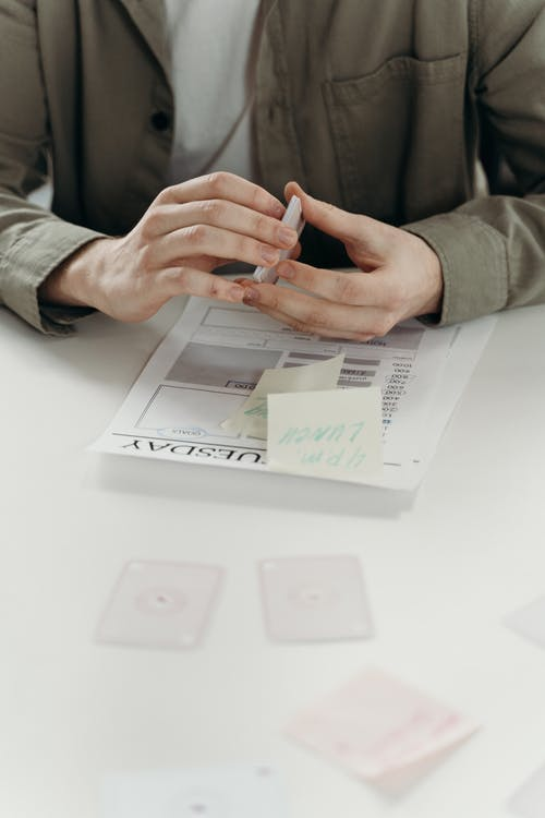 Person Holding Cards