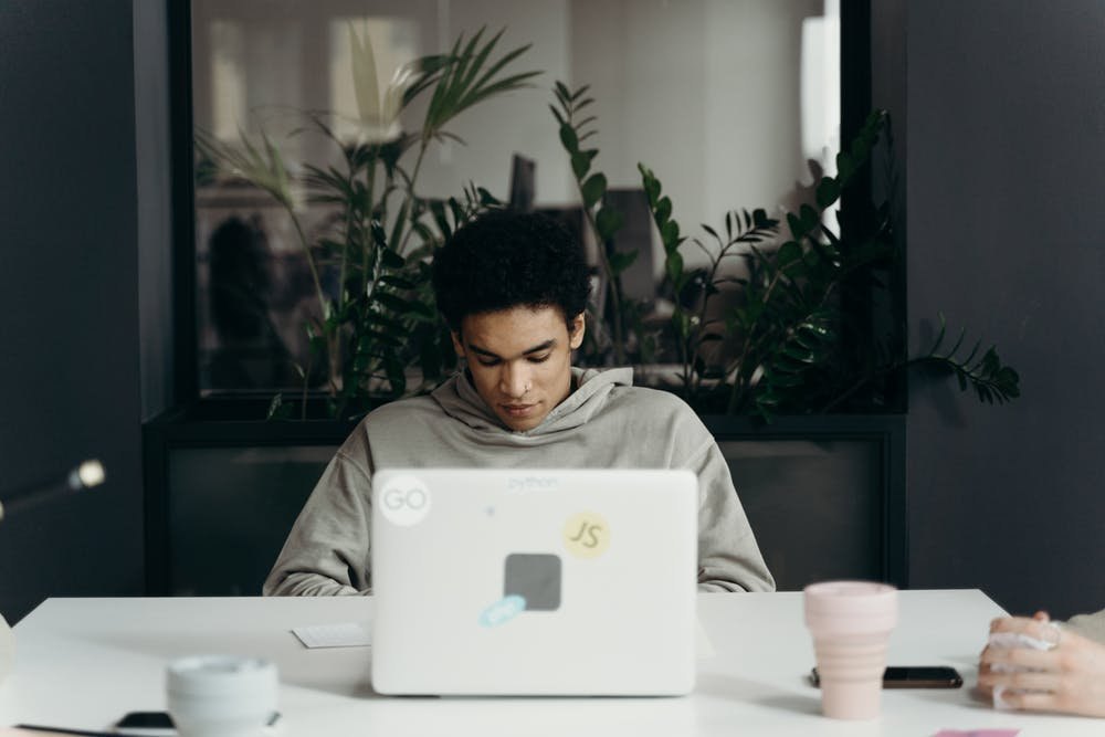 Man sitting in front of a laptop. | Photo: Pexels