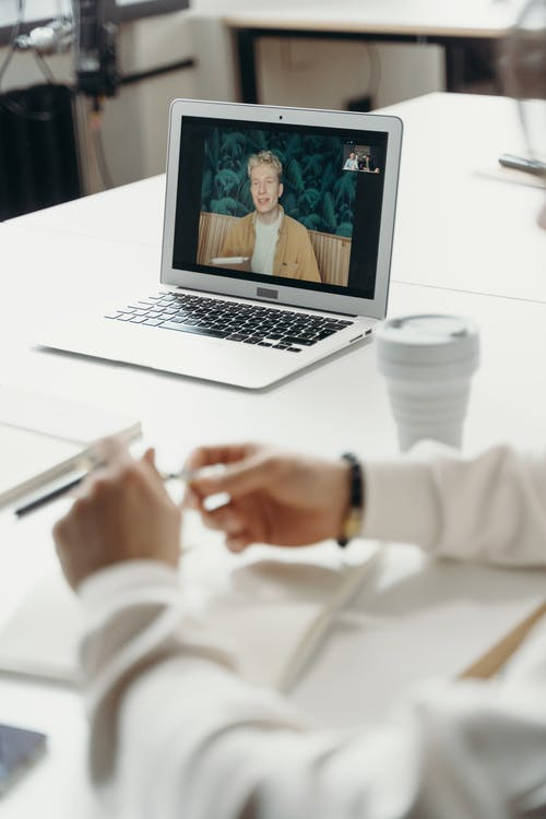 Man on a Laptop Screen During a Meeting