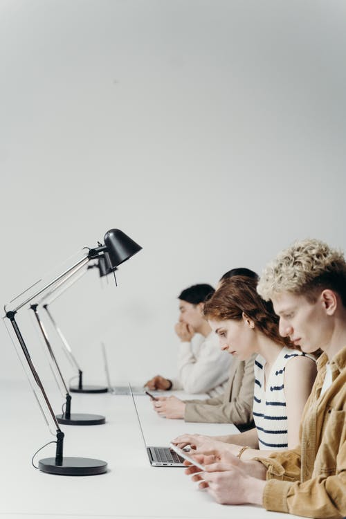 People Sitting at the Table Working