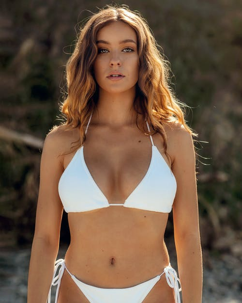 A Sexy Woman in White Bikini Looking at Camera
