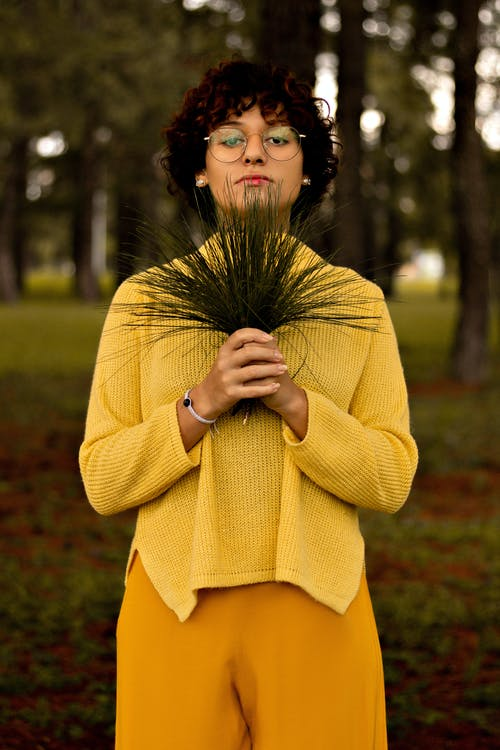 Woman in Yellow Long Sleeve Dress Standing on Green Grass Field