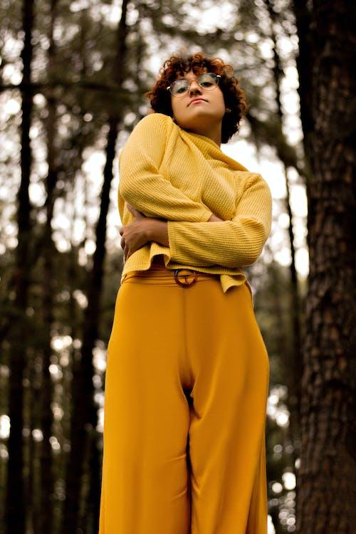 Woman in Yellow Long Sleeve Dress Standing Near Trees