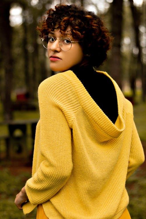 Woman in Yellow Knit Sweater Wearing Black Framed Eyeglasses