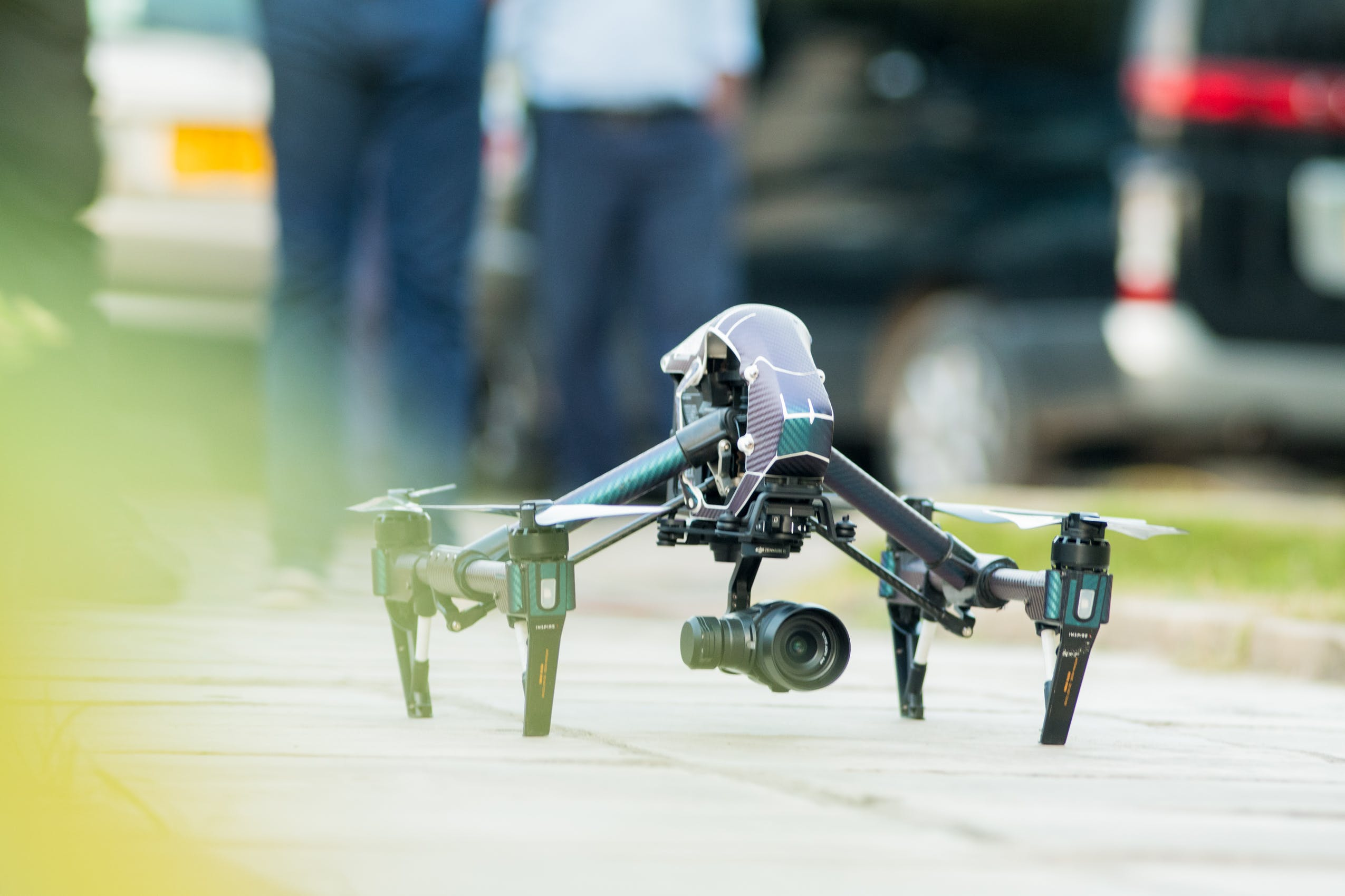 Gray and Green Quadcopter Drone on Ground