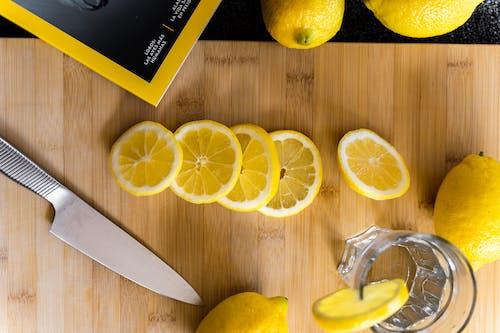 Sliced lemons for fresh drink on table