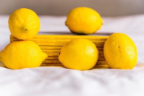 Fresh yellow lemons on table