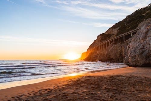 Ilmainen kuvapankkikuva tunnisteilla aalto, auringonlasku, auringonvalo