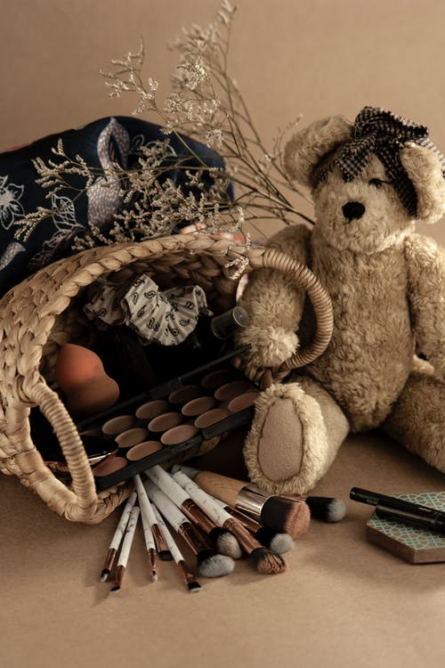 Basket with beauty products and teddy bear