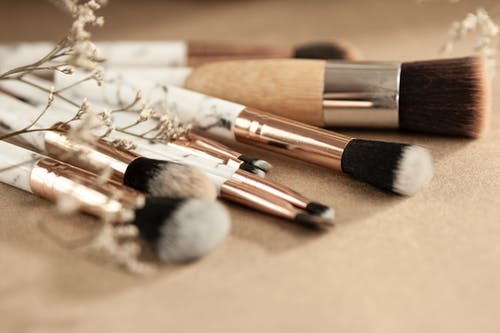 Clean makeup brushes with dried flowers