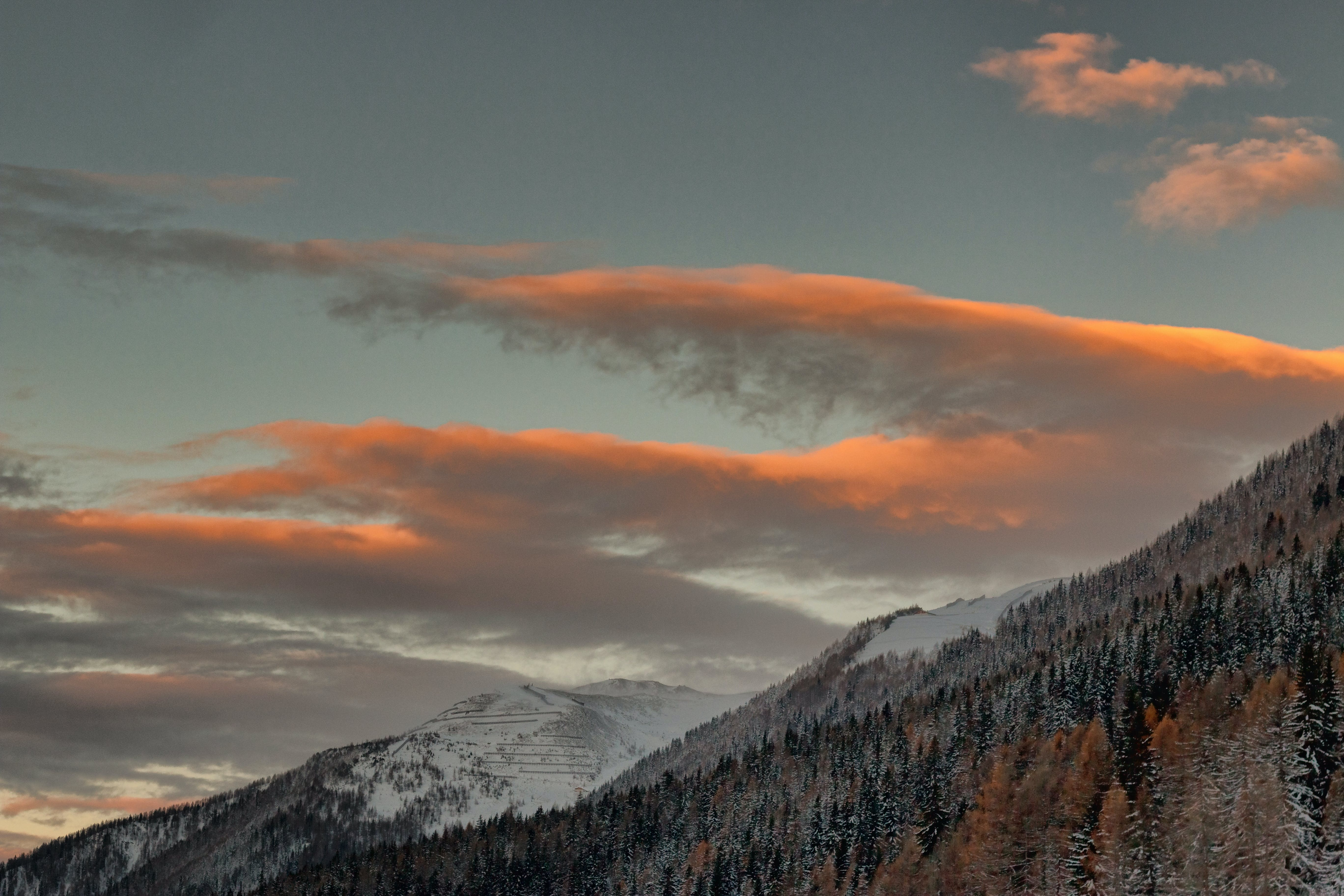 A View of Snowy Mountains Under Cloudy Sky