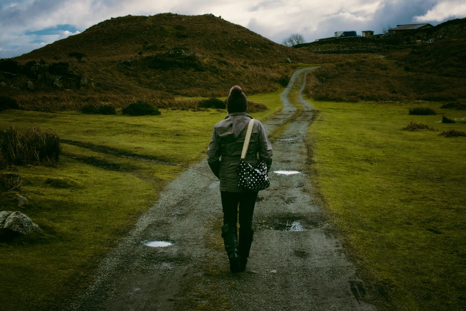 Person Standing in Pathway