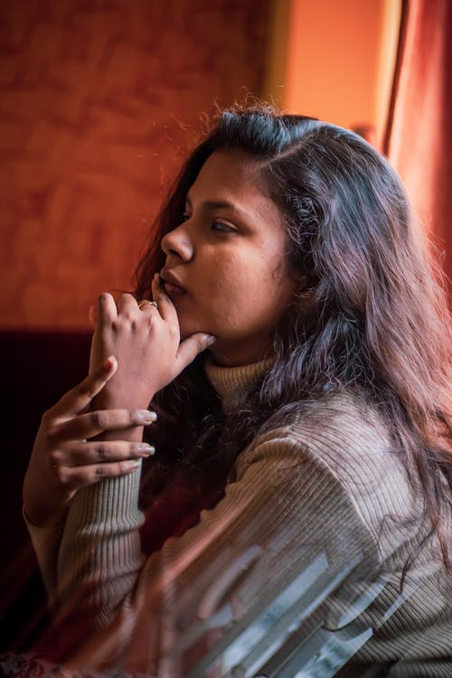 Indian woman sitting in room