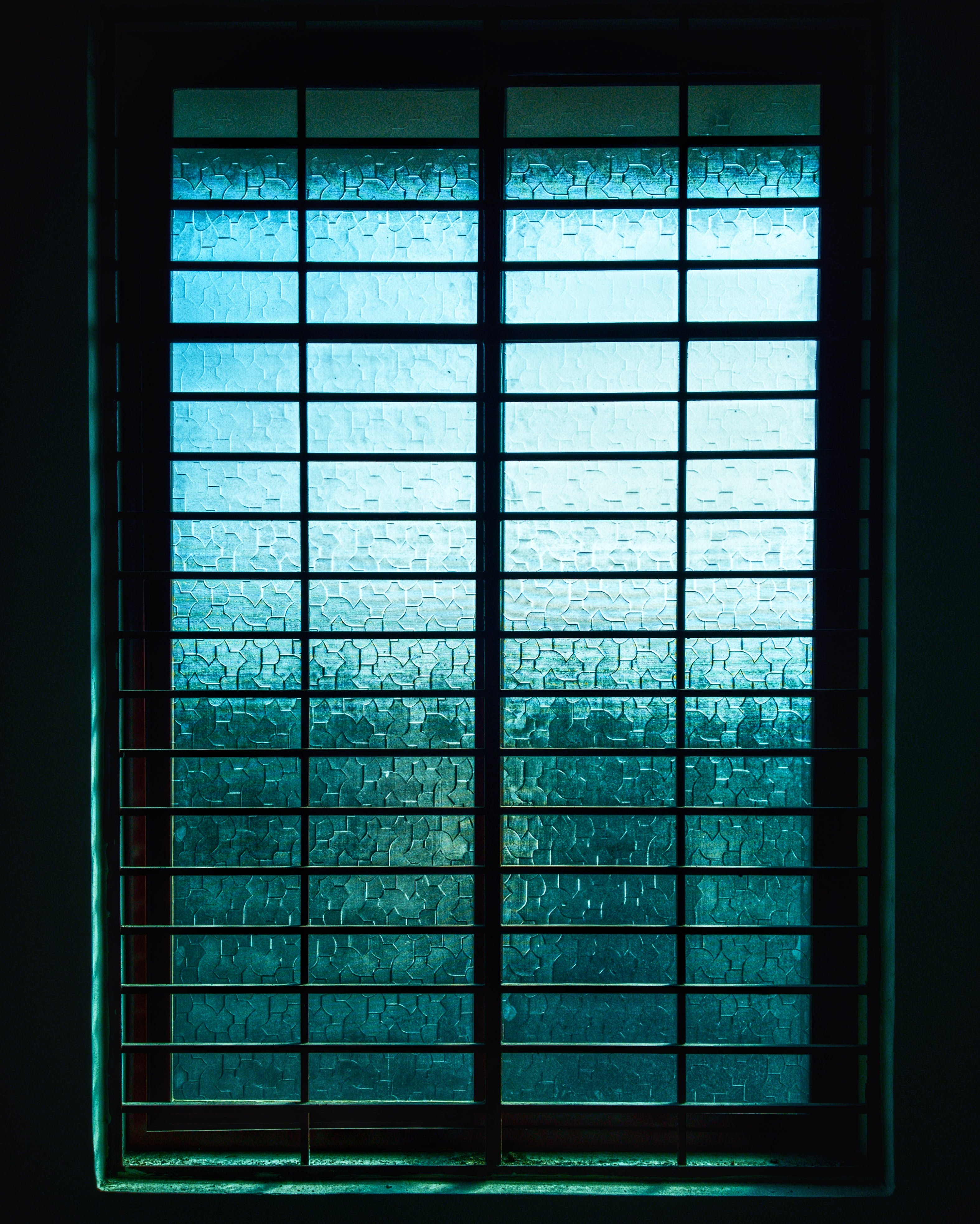 Closed Black Metal-framed Frosted Glass Windowpane