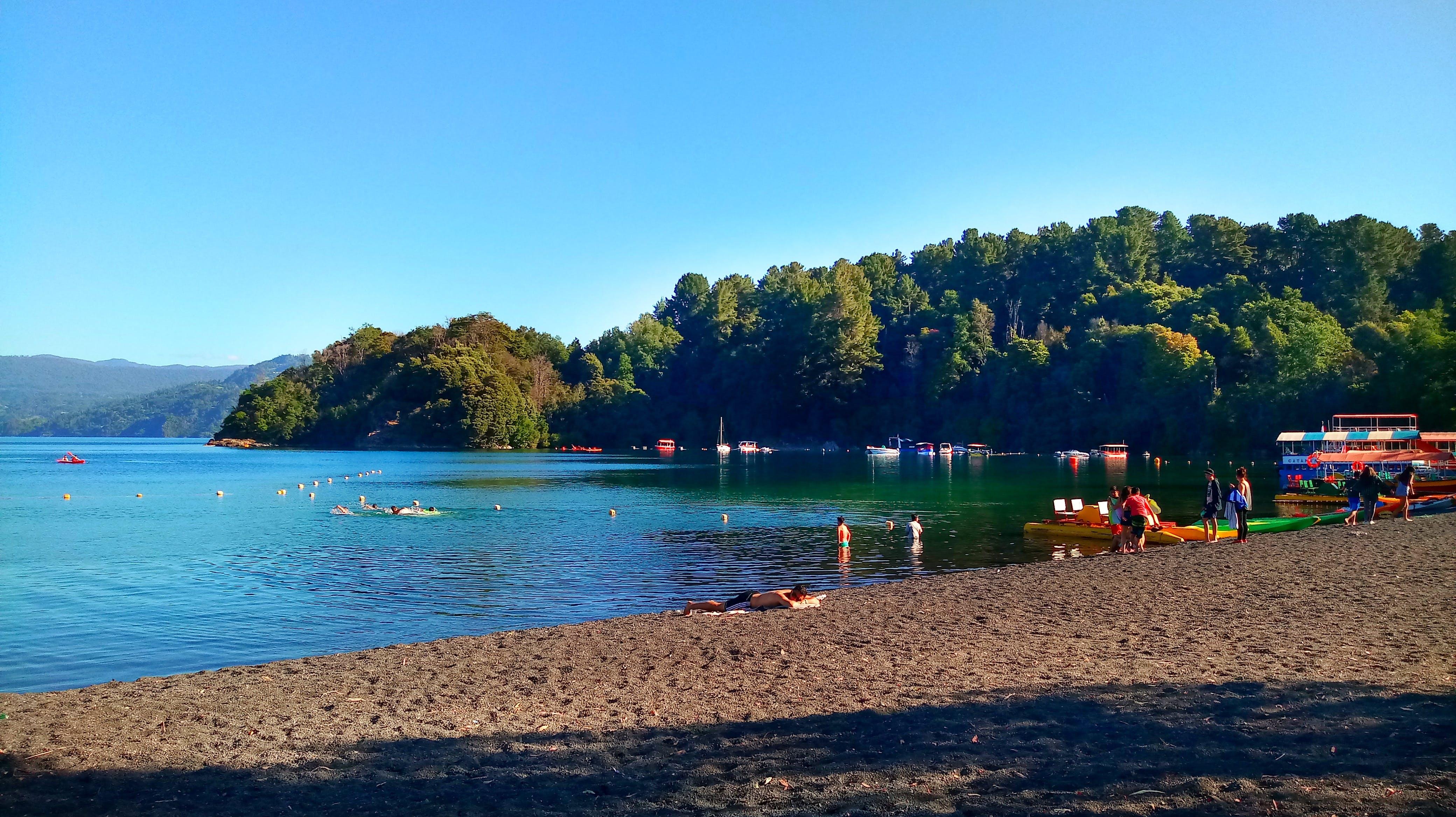 Free stock photo of beach, boats, mountain, people