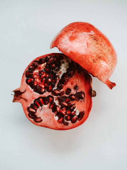 Red Sliced Fruit on White Surface